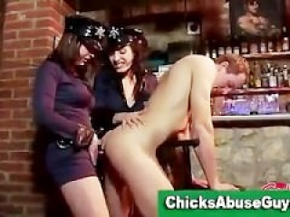 Police girls pegging man at the bar